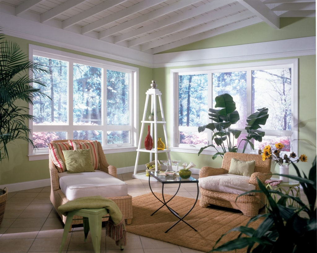 White awning windows letting natural light into sitting room