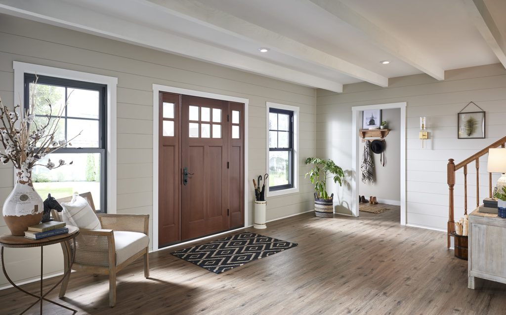 Rustic-modern foyer with double hung windows and wood entry door