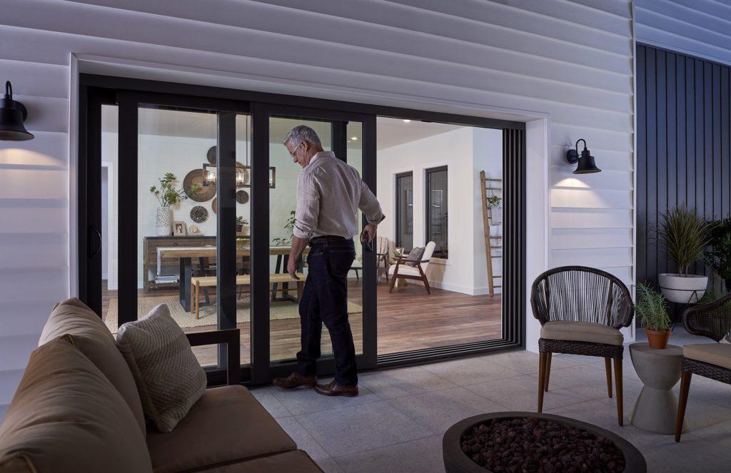 Man entering house through sliding patio door