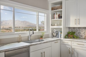 Kitchen with an awning window and mountain view.