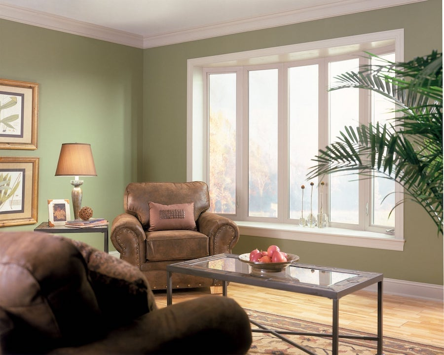 Bay and bow windows let light into living room.