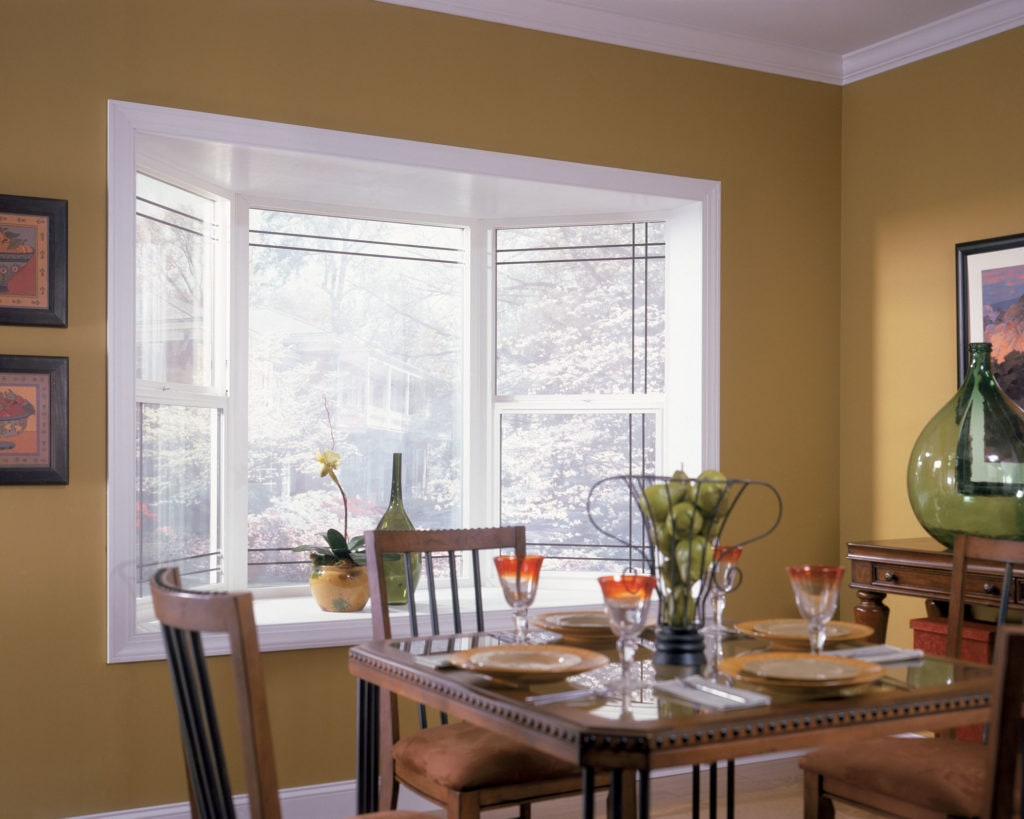 Bay and bow window showcases winterscape from dining room.