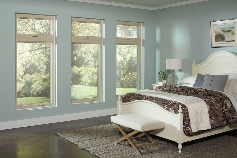 Casement windows let light into in large bedroom.