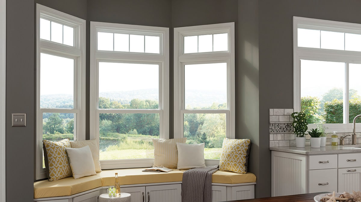 Window seat features double hung window.