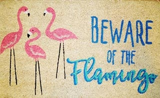 beware of the flamingo door mat