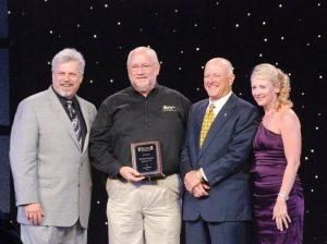 window world beaumont owners accepting award