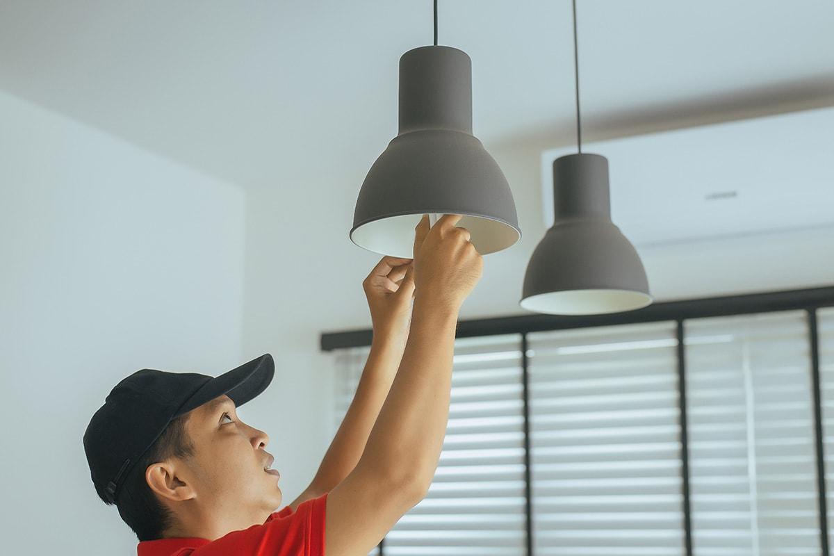 man changing lightbulbs