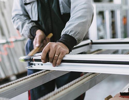 man preparing windows at warehouse