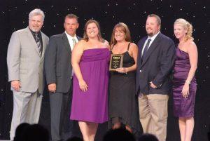 window world kansas city owners receiving award