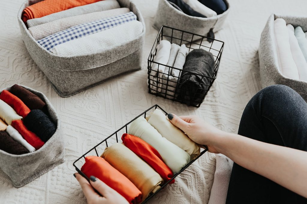 organizing clothes In baskets
