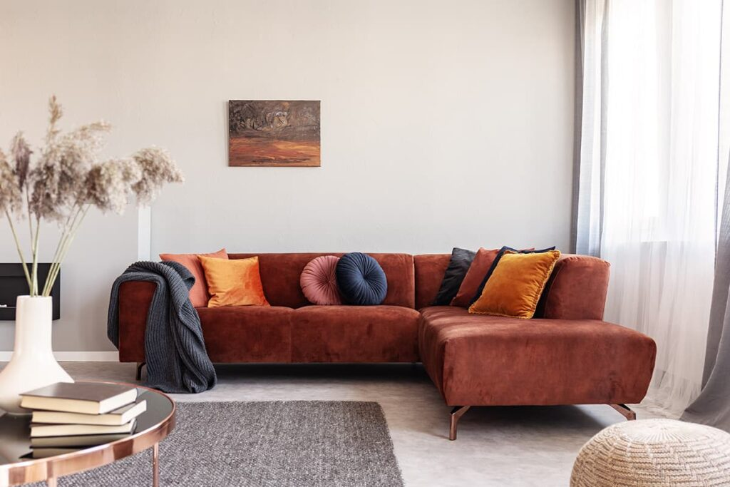 red couch with velvet pillows