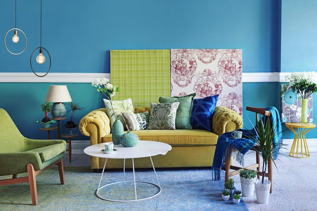 room with blue walls and mixed patterns